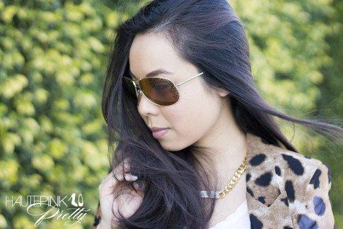 An Dyer wearing Vaunt Eyewear Leopard Etched Aviator Sunglasses, Leopard Mesh Blazer, Glint & Gleam Necklace