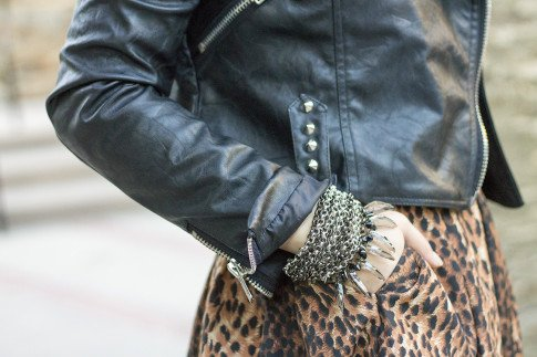 An Dyer wearing spiked leather moto heavy metal Insane Jungle Jacket, Zara Leopard Skirt, Coco Rocha Collection for Senhoa Chantha Bracelets