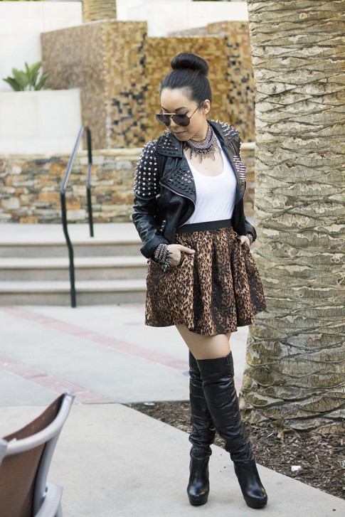 An Dyer wearing spiked leather moto heavy metal Insane Jungle Jacket, Zara Leopard Skirt, White Tee, OTK Over The Knee Leather Boots, Coco Rocha Collection for Senhoa, Celine Aviators 2