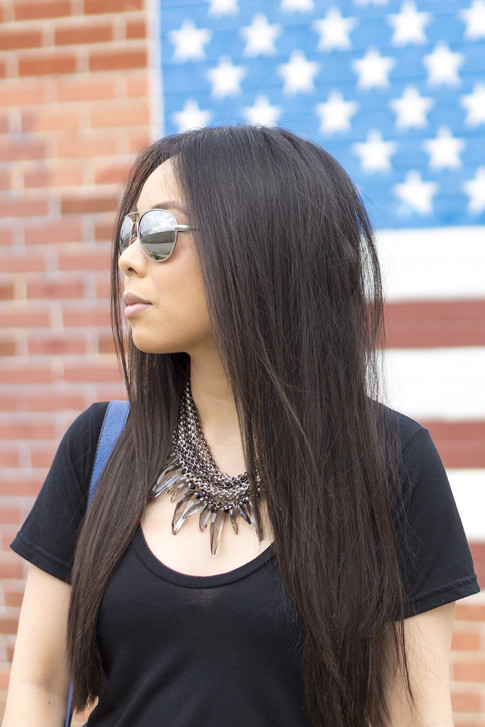 An Dyer wearing Ditto Brand Jeans, Coco Rocha Senhoa Jewelry, Mirrored Aviators, Black Tshirt 2