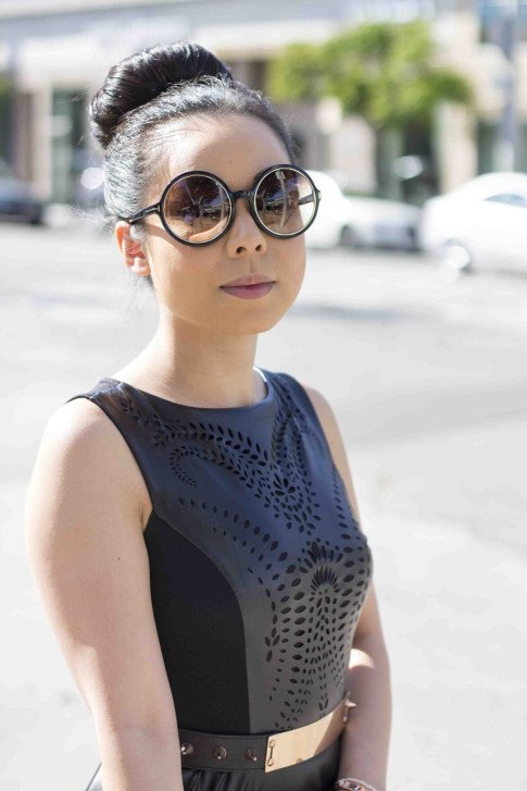 An Dyer wearing Lavishville LASER CUT FIT AND FLARE PONTE AND PLEATHER DRESS, Tom Ford Carrie Sunglasses, ASOS Black Plate And Spike Detail Waist Belt