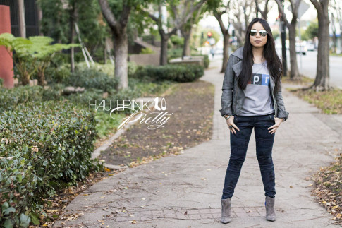 An Dyer wearing NPR Sweatshirt Tee by Chaser Brand, Zara blue camo pants, SoleSociety Aster Boots, Grey Perforated Leather Moto Jacket, Mirrored Aviators, Glint & Gleam Love Silver Bracelets ShopLately 2