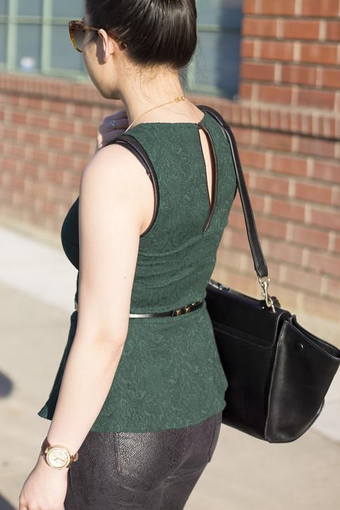 An Dyer wearing Zara Emerald Brocade Peplum Top, Snake Print Suede Pants, Cuore & Pelle Caterina Bag