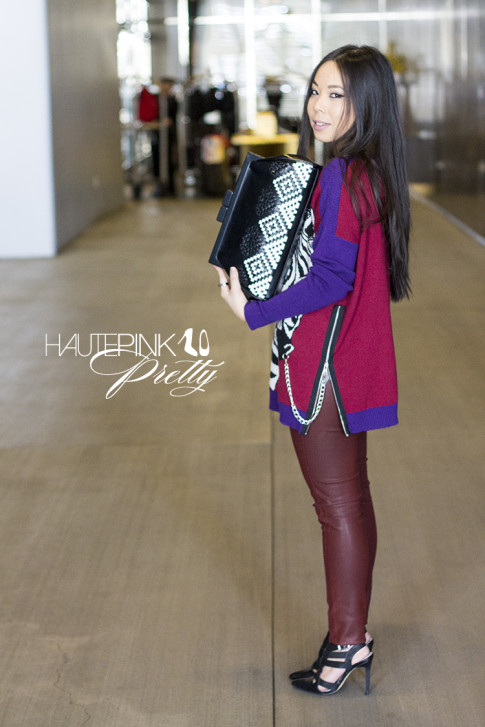 An Dyer wearing Ainsley Zebra TALA INTARSIA PULLOVER, Bleulab Ruby Coated Reversible Jeans, ShoeMint Garbo Pumps, Koret Woven Aztec Neo Framed Clutch