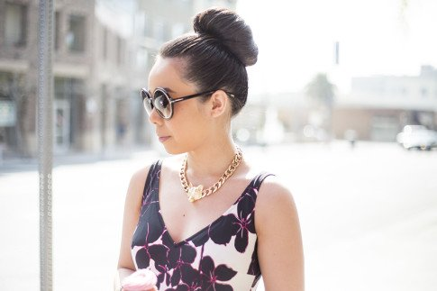 An Dyer wearing Anita Rosa Faia Exotic Black Swimsuit, Glint & Gleam Fox Necklace, Tom Ford Carrie Sunglasses