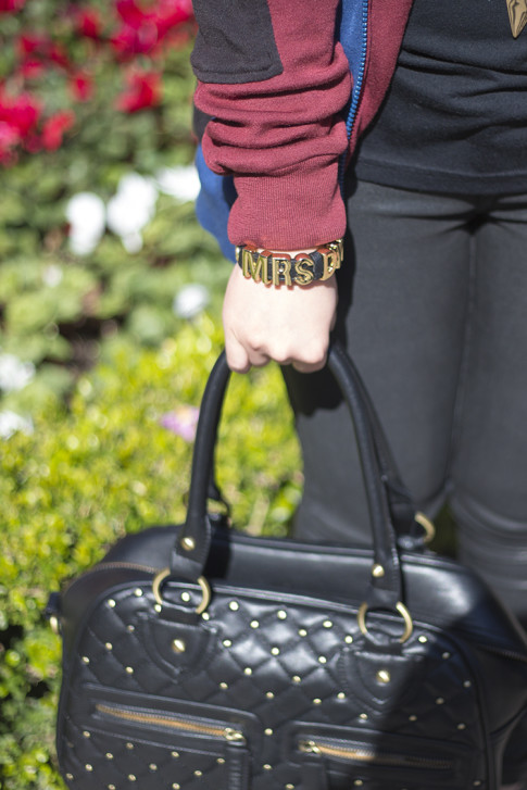 An Dyer wearing BCBGeneration Custom Afflirmation Bracelet MRS DYER and THEIT Studded Bossi Bag
