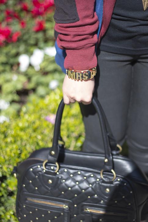 An Dyer wearing BCBGeneration Custom Afflirmation Bracelet MRS DYER and THEIT Studded Bossi Bag