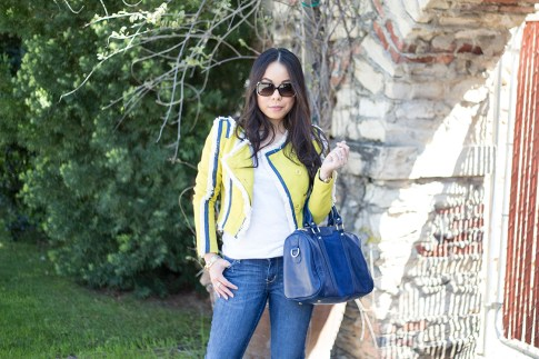 An Dyer wearing Lucy Paris Denim Fringe Chartreuse Jacket, Sole Society Kaylin Navy Bag, Fendi Classico Sunglasses, Levi's Jeans