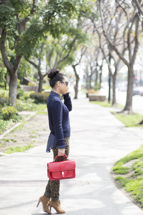 An Dyer wearing Sole Society Britt Messenger Bag in Red & Julianne Hough Angela Booties, Big Star Leopard Skinny Jeans, Navy Polka Dot Blouse, Prada Baroque Sunglasses, American Apparel Navy Cable Knit