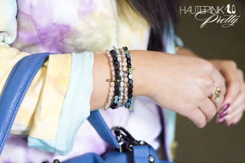 An Dyer wearing This Is A Love Song's No Doubt Tie Dye Moto Jacket, Ditto Jeans, Haute Betts Sanctuary Bracelets