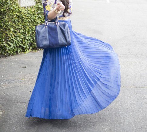 An Dyer wearing Bebe Pleated Long Skirt Maxi Skirt in Cobalt, Sole Society Kaylin Navy Bag, Zara Blue Floral Blouse, Asos Studded Plate Belt