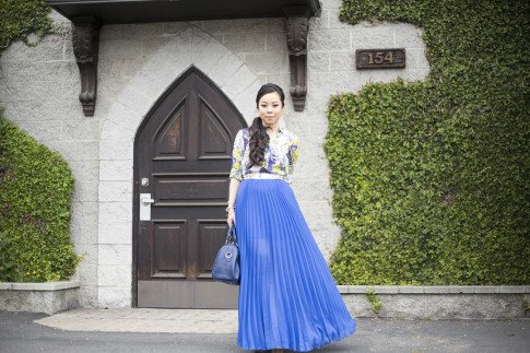 An Dyer wearing Bebe Pleated Long Skirt Maxi Skirt in Nautical Blue Cobalt, Sole Society Kaylin Navy Bag, Zara Blue Floral Blouse, Asos Studded Plate Belt, Jessica Simpson Dany Platforms
