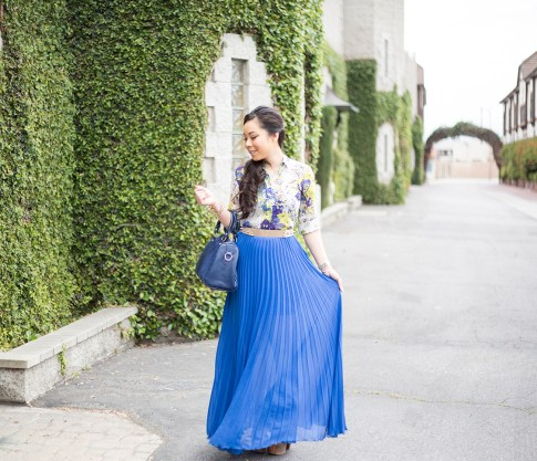 An Dyer wearing Bebe Pleated Long Skirt Maxi Skirt in Nautical Blue Cobalt, Sole Society Kaylin Navy Bag, Zara Blue Floral Blouse, Asos Studded Plate Belt, Jessica Simpson Dany