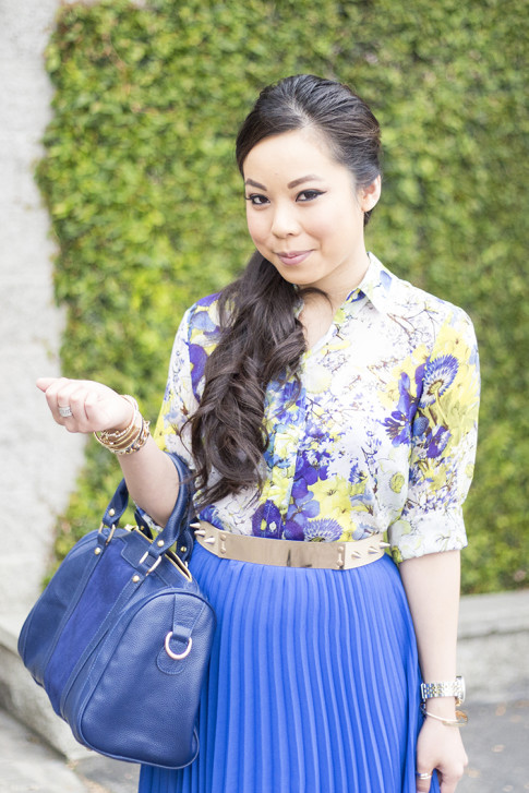 An Dyer wearing Bebe Pleated Long Skirt in Nautical Blue Cobalt, Sole Society Kaylin Navy Bag, Zara Blue Floral Blouse, Asos Studded Plate Belt