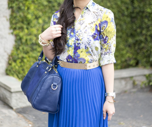 An Dyer wearing Bebe Pleated Long Skirt in Nautical Blue Cobalt, Sole Society Kaylin Navy Bag, Zara Blue Floral Blouse, Asos Studded Plate Belt, Glint & GLeam Jewelry ShopLately