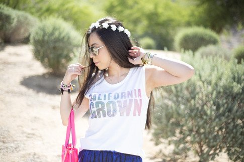 An Dyer wearing Lovers & Friends California Grown Tank, BCBGMaxazria Carly Zipper Tote in Pink, C&C California Flower Halo, Haute Betts Gypsy & Candy Pop Sweet Tarts Bracelets, Kim & Zozi ring