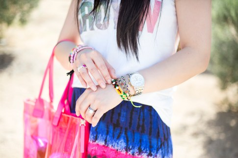 An Dyer wearing Lovers & Friends California Grown Tank, BCBGMaxazria Carly Zipper Tote in Pink, Haute Betts Gypsy & Candy Pop Sweet Tarts Bracelets, Kim & Zozi Chain Bracelet, Nicki Jean Ring, Natalie B Is