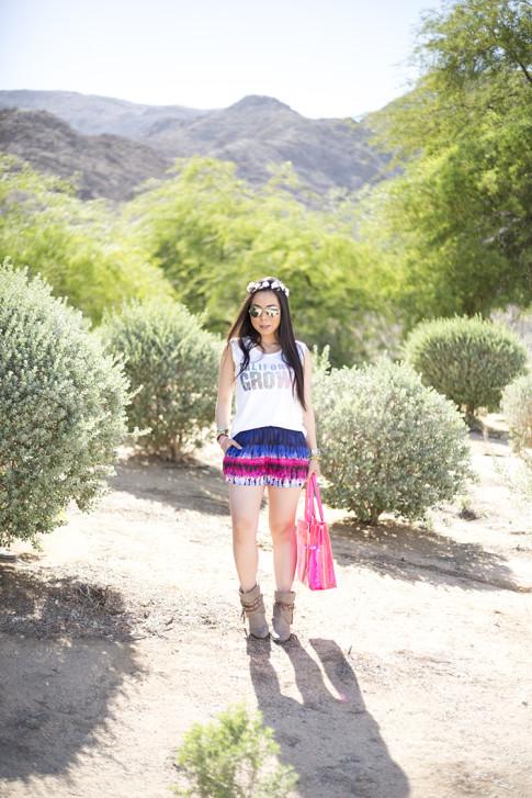 An Dyer wearing Lovers & Friends California Grown Tank & Tie Dye Woodstock Shorts, Steve Madden BackTalk boots, BCBGMaxazria Carly Zipper Tote in Pink, C&C California Flower Halo