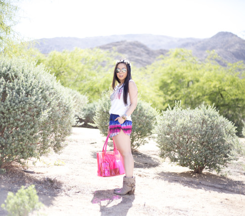 An Dyer wearing Lovers & Friends California Grown Tank & Tie Dye Woodstock Shorts, Steve Madden BackTalk boots, BCBGMaxazria Pink Carly Zipper Tote, C&C California Flower Halo