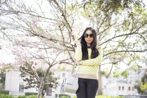 An Dyer wearing Lucca Couture Neon Chevron Sweater & Studded Bow Bracelet, Frederick's of Hollywood Grey Satchel Bag, Prada Baroque Sunglasses, Forever 21 Studded Collar Black Blouse