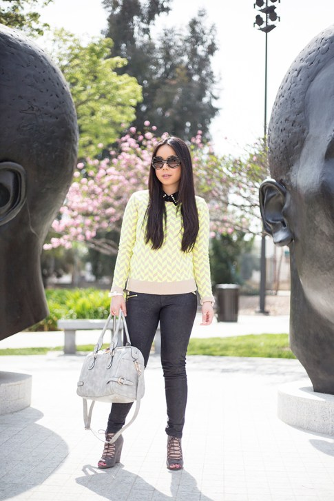 An Dyer wearing Lucca Couture Neon Chevron Sweater & Studded Bow Bracelet, ShoeMint Jordane, Frederick's of Hollywood Grey Satchel Bag, Prada Baroque Sunglasses, Forever 21 Studded Collar Black Blouse