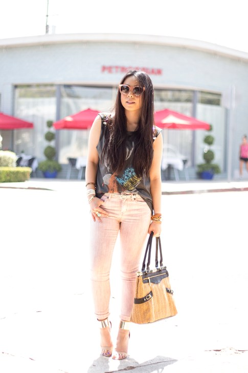 An Dyer wearing Rich & Skinny Jeans Skinny Ankle Peg in Piglet, Bebe Jacqueline Metal Cuff Stilleto Sandals, Celine Paris Audrey Sunglasses, Olivia & Joy Swanky Straw Satchel, Vintage Havana Eagle Jeweled