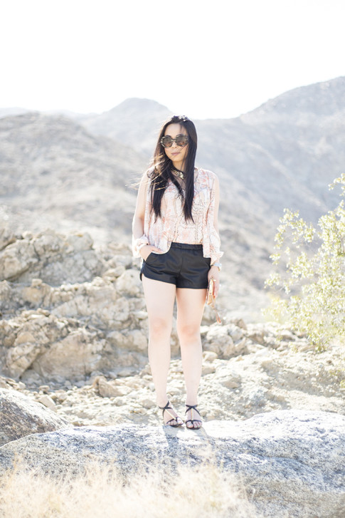 An Dyer wearing ShoeDazzle Lia, Lovers & Friends Daydream Blouse in Abstract Pastel, Lucca Couture Studded Bow Bracelet, George Gina Lucy peach koi fish embossed clutch Wristlet, Prada Baroque Sunglasses