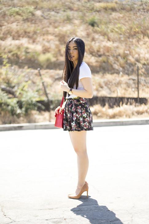 An Dyer wearing ShoeMint Lulu Nude Suede Pump, Sole Society Britt Red Satchel, BCBGeneration DIY Custom Affirmation Bracelets as a Belt, Michael Stars VNeck Tee, Forever 21 Floral Shorts