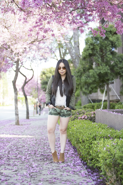 An Dyer wearing Vintage Havana Knit Top, YMI Jeans Camouflage Shorts, Sole Society Angela Booties, La Mere Watch, Vaunt Aviators, Zara Combined Jacket