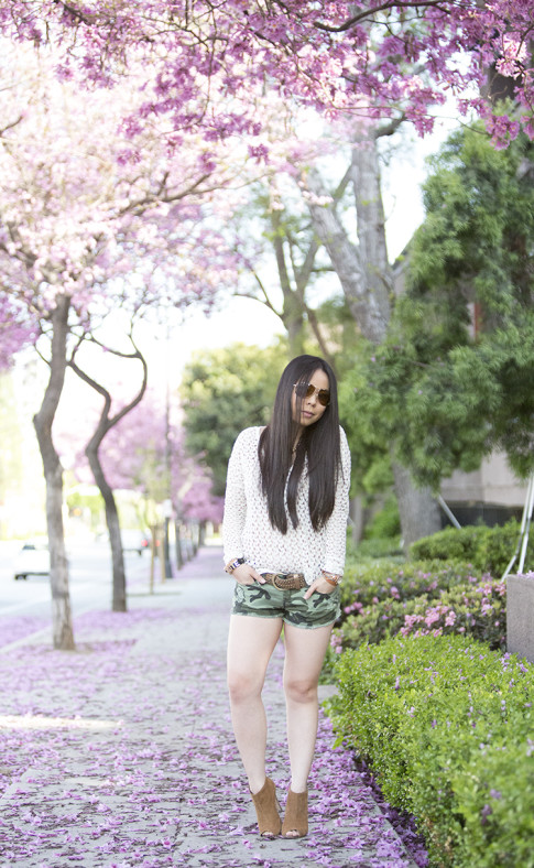An Dyer wearing Vintage Havana Sheer Knit Top, YMI Jeans Camouflage Shorts, Sole Society Angela Booties, La Mere Watch, Vaunt Aviators, BCBGeneration Affirmation Bracelet