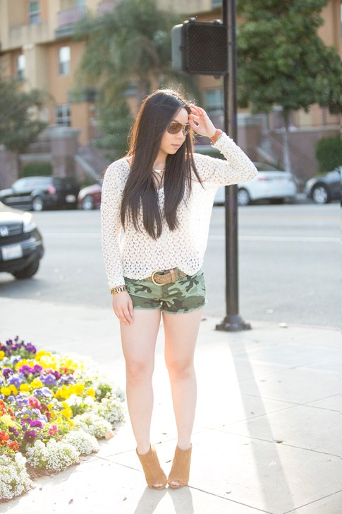 An Dyer wearing Vintage Havana Sheer Knit Top, YMI Jeans Camouflage Shorts, Sole Society Angela Booties, La Mere Watch, Vaunt Aviators, BCBGeneration Affirmation Bracelet, Glint & Gleam Identity Necklace S