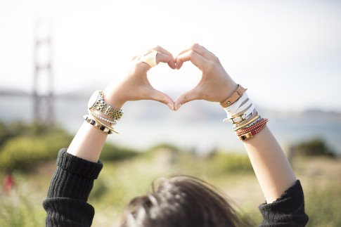 An Dyer heart shaped hands wearing Chic Peak Champagne Glass Ring, Michael Kors Chronograph Watch, Hauskrft Hello Bracelet, Hermes White Hapi 3mm, Sole Society Bracelets, Golden Gate Bridge, San Francisco
