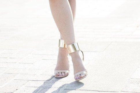 An Dyer wearing Bebe Jacqueline Gold Cuff Sandals