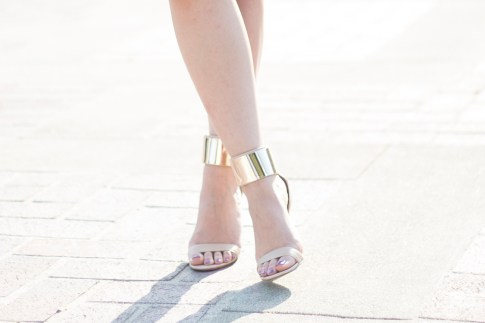 An Dyer wearing Bebe Jacqueline Gold Cuff Sandals