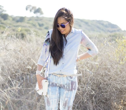 An Dyer wearing BleuLab Drip Tie Dye Ocean, Sole Society Elsie Bag in White, Glint & Gleam iridescent mirrored sunglasses & Belt, Zara Denim Tropical Combined Shirt, Hermes Hapi 3mm Bracelet