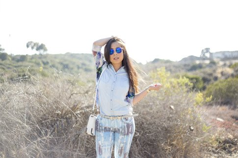 An Dyer wearing BleuLab Drip Tie Dye Ocean, Sole Society Elsie Bag in White, Glint & Gleam iridescent mirrored sunglasses & Blet, Zara Denim Tropical Combined Shirt Hermes Hapi 3mm