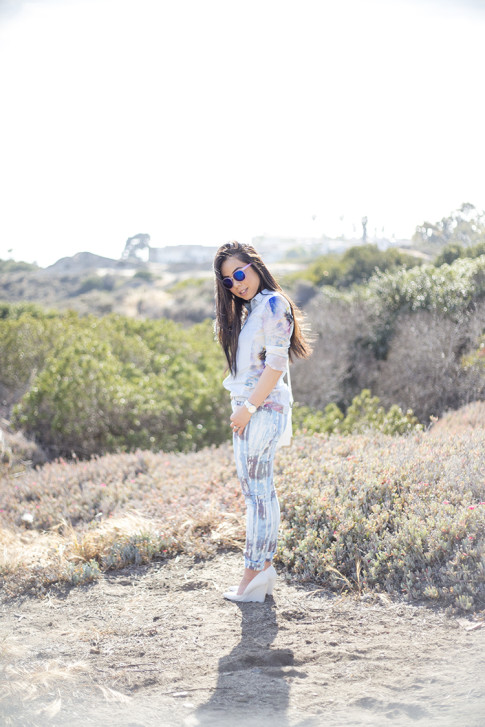 An Dyer wearing BleuLab Drip Tie Dye Ocean, Sole Society Elsie Bag in White, Glint & Gleam iridescent mirrored sunglasses, Zara White Wedge Pump & Denim Tropical Combined Shirt