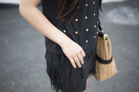 An Dyer wearing Gorjana Griffin Chevron Bracelet and Lena Shimmer Double Bar Ring, Lovers & Friends Kiss Me Top, Zara Leather Fringe Skirt