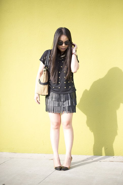 An Dyer wearing Lovers Friends Kiss Me Top, Sole Society Blakeley Nude Black Pumps, Zara Leather Fringe Skirt, Olivia Joy Swanky Straw Satchel, Black Cat Eye Metal Frame Sunglasses