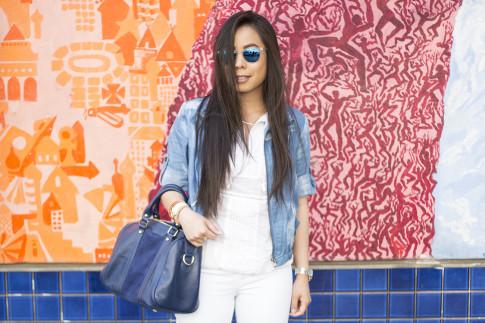 An Dyer wearing True Religion Brooklyn Flap Pocket White Skinny Jeans, Michael Stars  Blouson Hem Peasant Top, StyleMint Manor Tie Dye Denim Jacket, SoleSociety Kaylin Navy Bag in San Francisco Haight Street Style