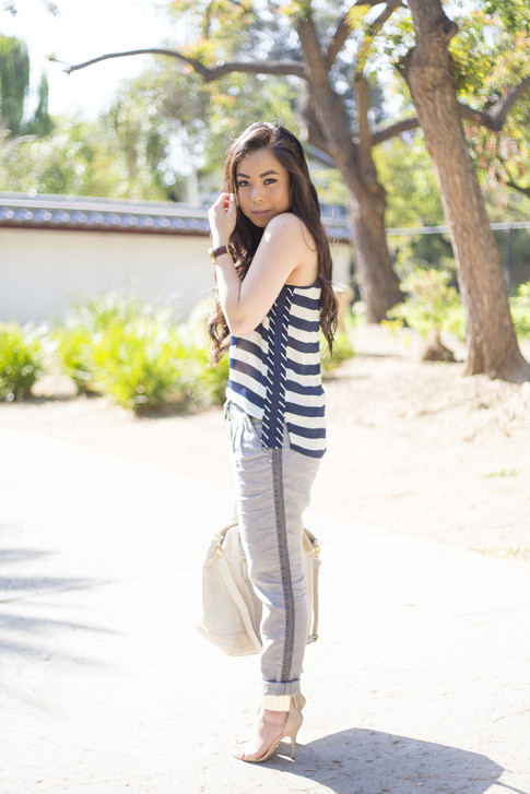 An Dyer wearing Michael Stars Stripe Silk Georgette Scoop Neck Tank Cuffed Ankle Pant w Tuxedo Stripe, Ben-Amun Layered Pendant Necklace, Frederick's of Hollywood Cream Studded Tote Bag, Bebe Jacqueline Metal Cuff Sandals