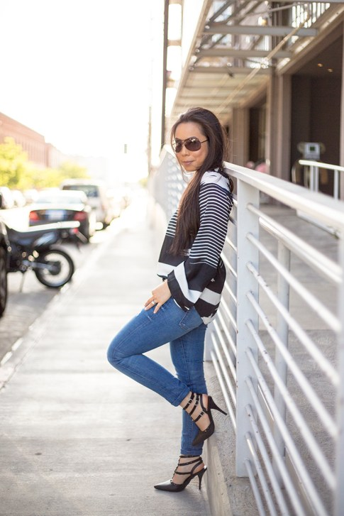 An Dyer wearing ShoeDazzle Sahara, Vaunt Black Snake Print Etched Aviator Sunglasses, Rich & Skinny Clinton Peg Jeans, Vintage Havana Striped Top
