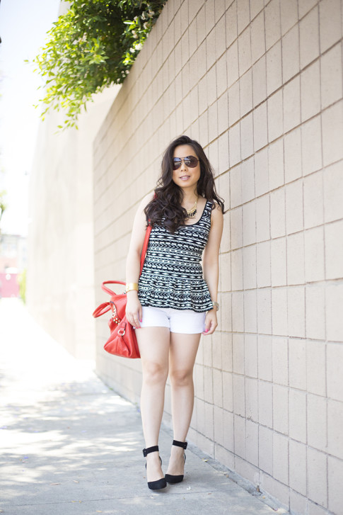 An Dyer wearing ShoeMint Lola Pumps, Torn by Ronny Kobo Michaela Tribal Peplum Tank, Mi Piaci Cuff, Vaunt Snake Aviators, Red V-Couture by Kooba Studded Bag
