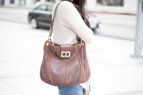 An Dyer wearing b makowsky Brown Leather Hobo Bag