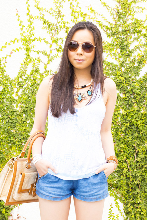 An Dyer wearing Brahmin Atelier Brookline Satchel, Zara Chambray Denim Shorts, Foster Grant Aviator Sunglasses, Honeydew Intimates Diamondback Cami, La Mer Collections Watch