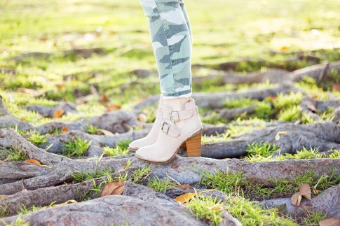 An Dyer wearing CJ by Cookie Johnson Believe Camo Crop Stretch Jeans, & ShoeMint Milly Boots