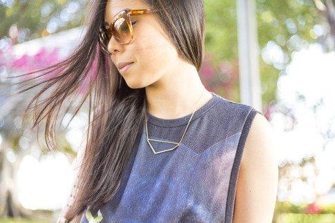 An Dyer wearing Elizabeth & James Lafayette Sunglasses and Glint & Gleam Shifting Shape Necklace ShopLately