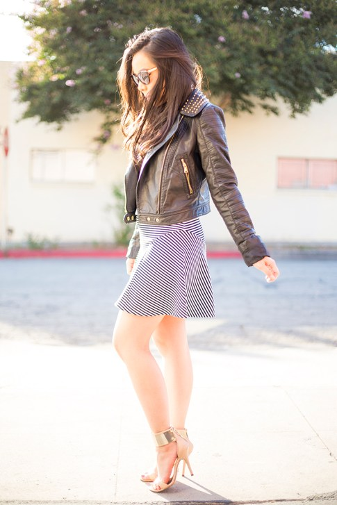 An Dyer wearing Express Seamed Minus the Leather Front Tank, Natural Waist Seamed Strip Skirt, Studded Cropped Minus the Leather Moto Jacket, Bebe Jacqueline Metal Cuff Sandals, JewelMint Scene Stealer Necklace, Foster Grant Sunglasses