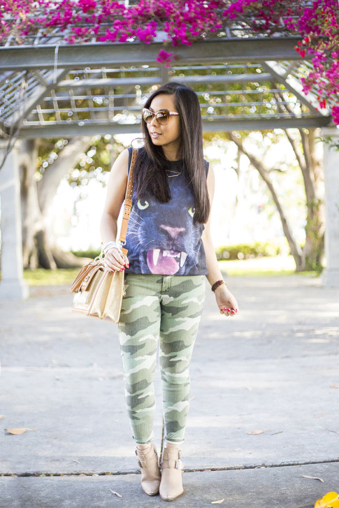 An Dyer wearing Forever 21 Jaguar Tank, Elizabeth & James Lafayette Sunglasses, Shifting Shape Necklace ShopLately, Brahmin Atelier Brookline Satchel, CJ by Cookie Johnson Camo Jeans, ShoeMint Milly boot