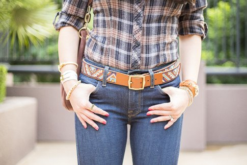 An Dyer wearing Lucky Brand Charlotte Kick Flare & Embroidered Belt, Glint & Gleam Luxe Sparkle Chain Bracelet, Buckled Beauty Cuff and So Square Ring